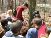 Author Steve Gabriel teaches school children about maple sugaring.